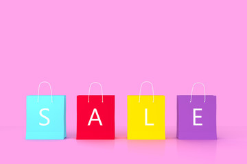 Colorful paper shopping bags with the word sale on it representing the concept of retail consumers and shoppers looking for bargains and low prices at the mall or department stores. minimal concept.