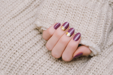 Beautiful female hand with purple nail design