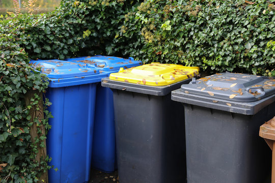 Garbage cans in different colors symbolizing recycling in Germany