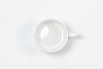 empty porcelain mug isolated on white background