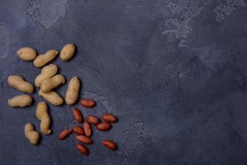 Peanuts on stone background