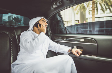 Business man sheik in his limousine talking about trades