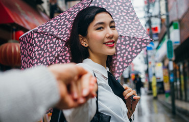 Beautiful japanese girl walking in Tokyo. Concept about teenagers and school