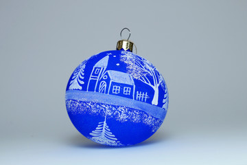 Christmas decoration - Blue Christmas ball with a pattern on a white background.