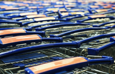 Shopping carts standing in a row in the big store