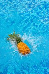 pineapple falling in water