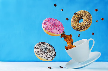 Flying multicolored donuts and a cup of coffee