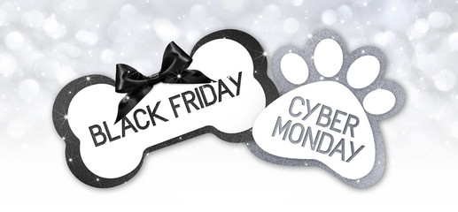 pet shop black friday and cyberg monday sale text write on gift card label with black ribbon bow on silver bright lights background