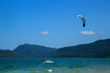 Kitesurfing on Walchensee with beautiful view towards the Bavarian Alps in Germany
