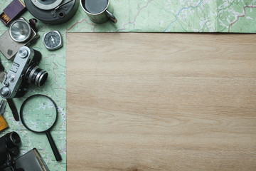 Camping, tourist equipment on the wooden background. Planning a trip