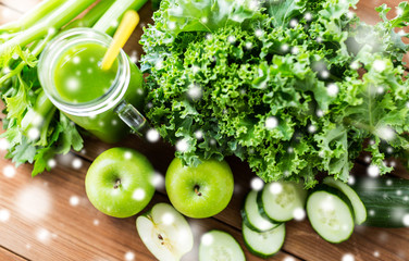 close up of jug with green juice and vegetables