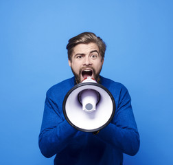 Screaming man with megaphone shouting