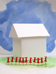 Paper model house on a colored background