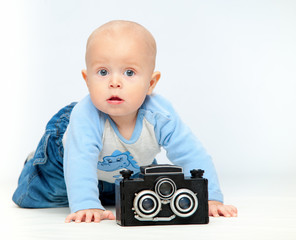 A small child and a camera..