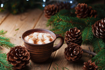 Cup of hot cocoa with marshmallows on rustic wooden table. Cozy christmas still life. Winter beverage.