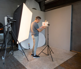 photographer working in the studio to prepare for macro photography. unintended photography