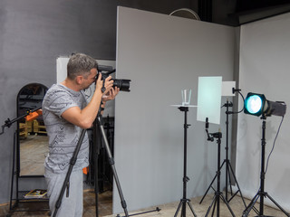 a young photographer in the process of working in a photography studio. unintended photography