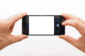 two male hands horizontally holding a smartphone ready to take a picture isolated on white