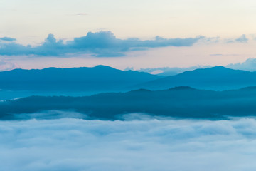 Beautiful Sea of mist in the morning with layer of mountain and sunrise