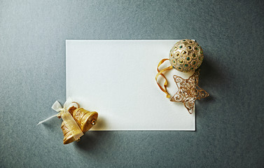 Blank Paper Card with Gold Christmas Decorations; flat lay arrangement