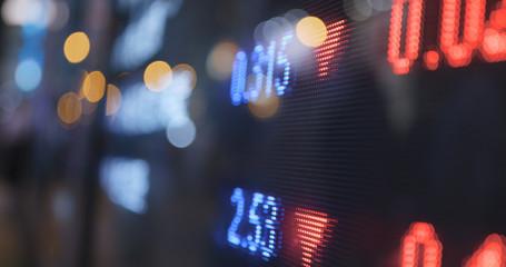 Stock market charts at night
