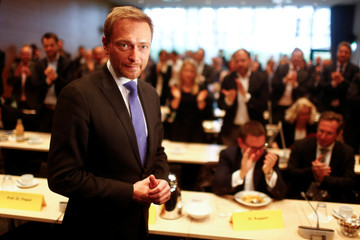 Free Democratic Party (FDP) leader Christian Lindner poses for a photograph as he arrives for the board meeting at the party headquarters in Berlin