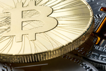 Golden bitcoin coin against other cryptocurrencies. Digital money and crypto-currencies concept
