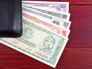 Old Peruvian money in the black wallet
