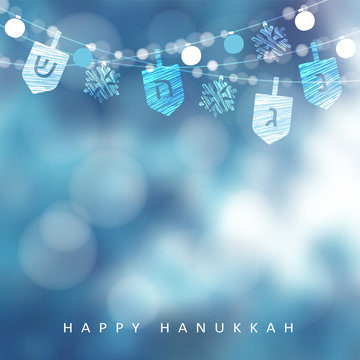 Hanukkah blue greeting card, invitation with string of lights, dreidels and snowflakes. Party decoration. Modern festive blurred vector illustration background for Jewish Festival of light holiday.