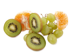 Sliced pieces of raw fruit on white background