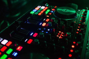 backlit buttons on modern Board of management of music for DJ with different colors