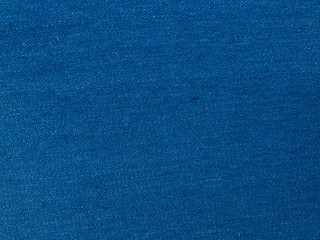 Blue denim textile texture.