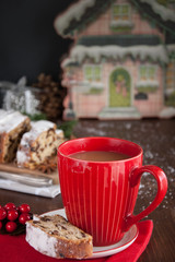 Sliced Christmas Stollen. Traditional german christmas cake with dried fruits and icing сигар with red coffee mug