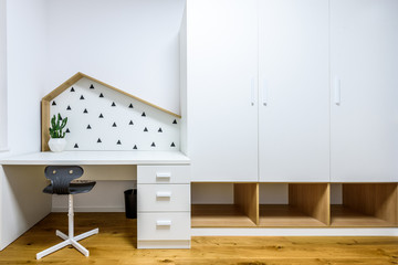 Modern children play room with bed and study desk.