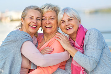 Group of smiling senior women standing outside