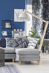 Blue apartment with wooden lamp