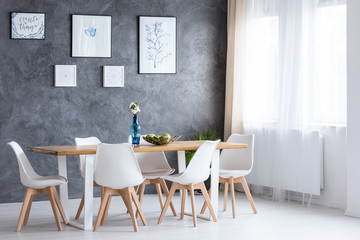 Bright dining room with paintings
