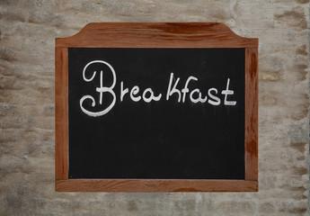 Chalk word breakfast on vintage blackboard on wall