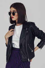 Wall Mural - Young beautiful woman in a black jacket.