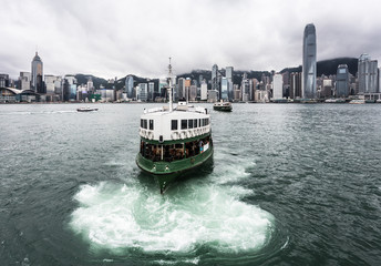 Foto op Aluminium Hong-Kong Star ferry on a cloudy sky with the famous skyline in Hong Kong.