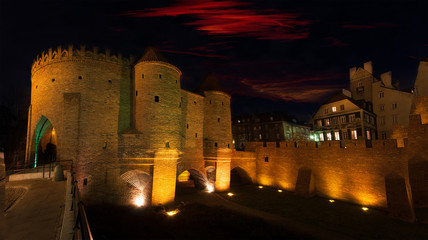 Panorama of Warsaw at night - view of the Barbican and Old Town