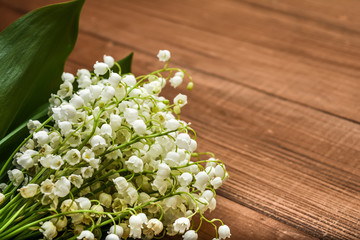 Poster de jardin Muguet de mai Lily of the valley flowers on a wooden background