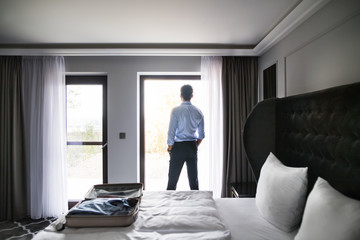 Mature businessman in a hotel room.