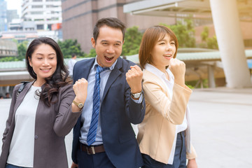 business success concept : businessman celebrating victory outdoors , happiness winner cheerful people