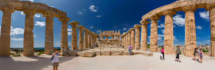 Some tourists visiting the ancient Greek temple in Selinuntea, Sicily, Italy.