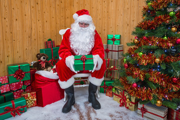 Santa Claus in a grotto giving you a gift.