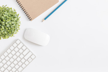 Flat lay photo of office desk with mouse and keyboard,White copyspace with pencil top view
