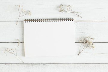 Flat lay photo of blank whtie notebook on whtie table