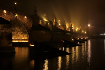 illuminated Charles Bridge (Karlův most) in the mist, Czech Republic