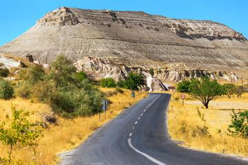 An ideal asphalt road in summer Cappadocia, concept of auto travel